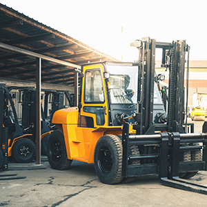Forklift trucks lined up with heavy leader in front