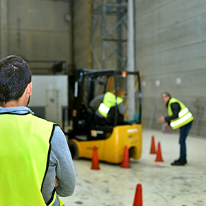 Man watching health and safety inspection in warehouse