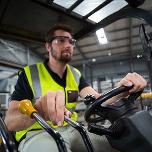 Man driving forklift truck as part of Thorough Examination