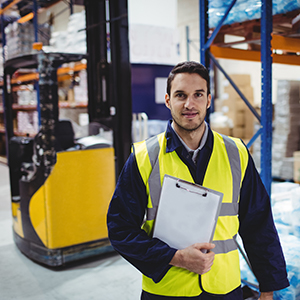 Engineer holding clip board infront of reach truck